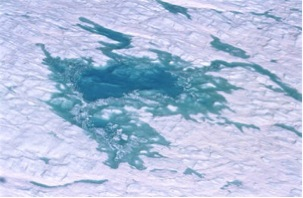 Ice sheet melt pond – John Maurer NSIDC