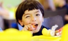 A year one pupil bites a carrot from his organic lunch box at the Max Dortu elementary school in Potsdam, Germany