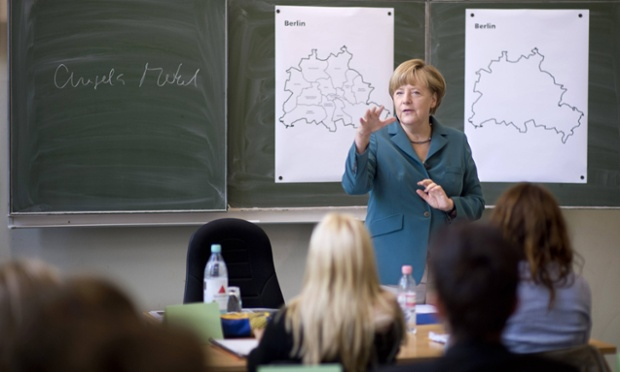German chancellor Angela Merkel talks about the building of the Berlin Wall during a school visit yesterday.