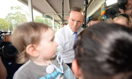 Opposition Leader Tony Abbott meets a young boy in Caboolture, Wednesday, Aug. 14, 2013.