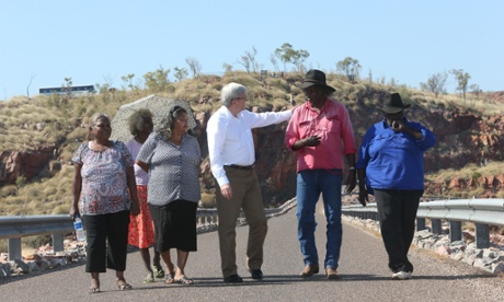 PM Kevin Rudd with traditional owners from Right, Button Joes, Ted Carlton, Edna O'Malley, Minnie Lumai (umbrella) and Helen Gerard on the Ord River Dam, Thursday 15th August 2013.