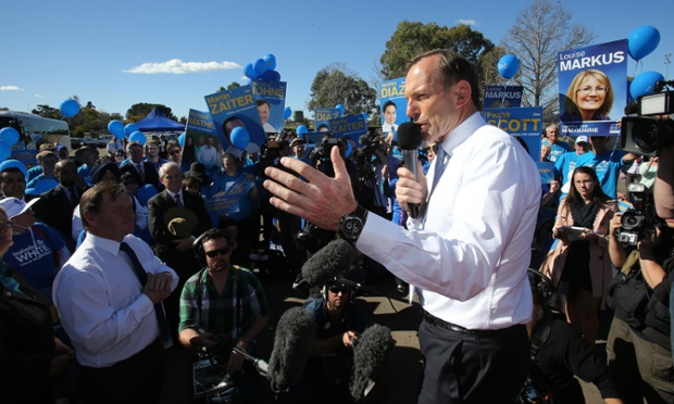 Opposition leader Tony Abbott addresses supporters at the launch of the Liberal party campaign bus during the 2013 federal election campaign.