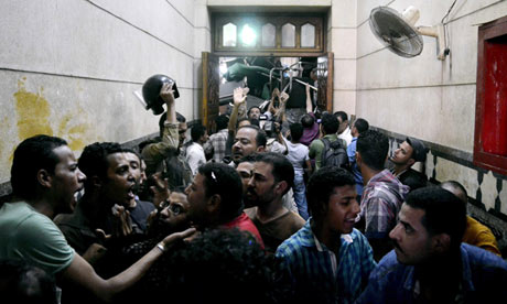 Security forces escort Muslim Brotherhood supporters away from the ­al-Fath mosque