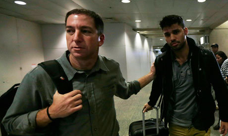 Glen Greenwald walks with his partner, David Miranda in Rio de Janeiro's international airport