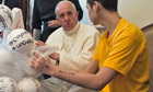 Pope Francis (L) meets with some young p