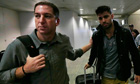 Journalist Greenwald walking with his partner Miranda in Rio de Janeiro airport