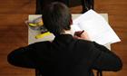 A boy sits a GCSE exam