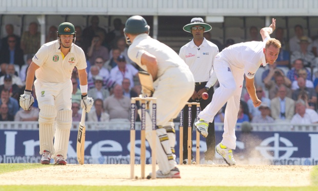 Stuart Broad bowls to Australia's Chris Rogers at the Oval.