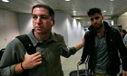 Greenwald walking with his partner Miranda in Rio de Janeiro's International Airport