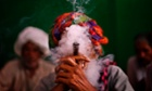 An Indian villager smokes during a rally demanding pension for elderly poor citizens in New Delhi, India.