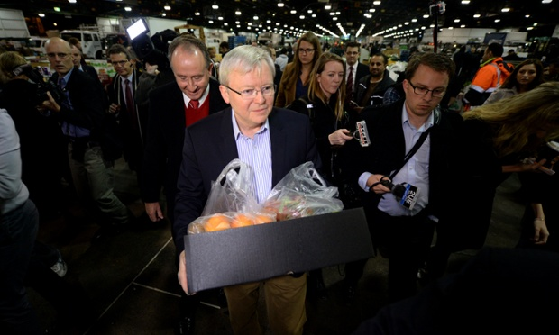 Prime Minister Kevin Rudd carries a box of fruit and vegetables he bought at Flemmington markets in Sydney, Friday, Aug. 23, 2013.
