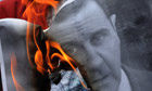A protestor burns a portrait of Syrian president Bashar al-A
