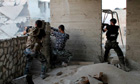 Syrian rebels fire on government forces in Aleppo