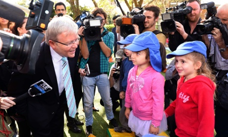Australian Prime Minister Kevin Rudd (L) speaks to young children during a visit to the Mascot Early Childhood Centre as he campaigns ahead of upcoming elections in Sydney on August 26, 2013.