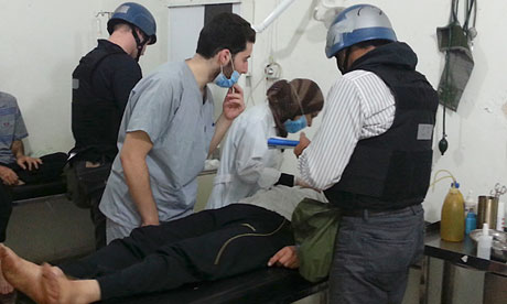 UN chemical weapons experts visit people affected by the apparent gas attack in Damascus suburb
