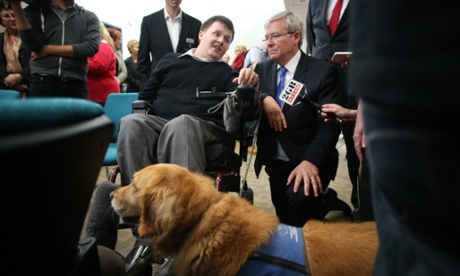 The Prime Minister Kevin Rudd meets Peter Darchad his assistance dog Phoebe at Rise a community care organisation in Middle Swan Perth, Friday 30 Aug. 2013.