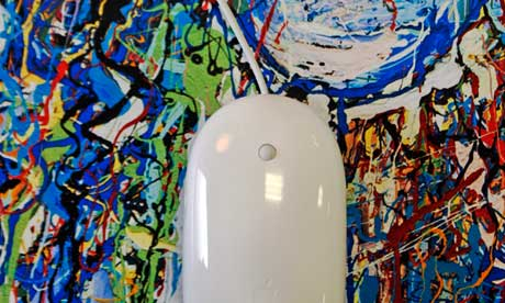 Apple mouse rests on a piece of abstract art