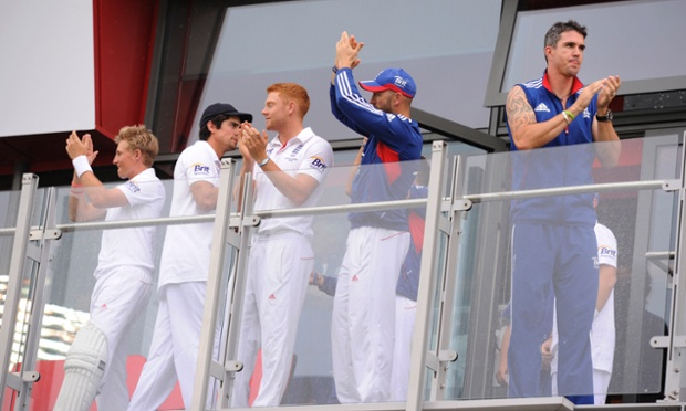 England players come out on to their balcony to celebrate retaining the Ashes.