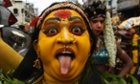 An Indian artist dressed like Hindu goddess Mahakali performs during the Bonalu festival in Hyderabad, India.