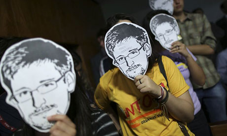 Supporters of Edward Snowden at a congressional hearing in Brazil on the NSA's surveillance programmes. Photograph: Ueslei Marcelino/Reuters