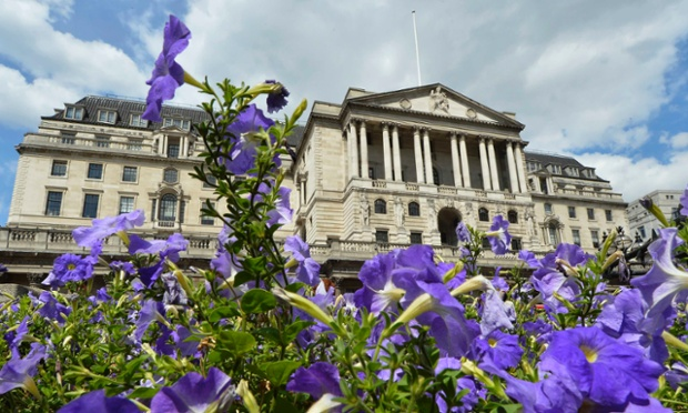 Flowers bloom in front of the Bank of England in the City of London August 6, 2013.