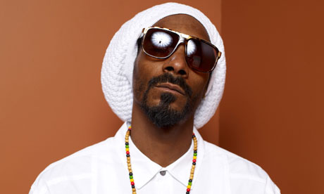 Smokin' … fans of Snoop Lion can pay $99.99 for virtual 'stickers' of a spliff to decorate their photos. Photograph: Matt Carr/Getty Images