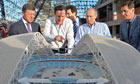 David Cameron and Vladimir Putin examine a model of a stadium for the 2014 winter Olympics