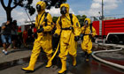 Emergency workers in protective suits at the scene of an ammonia leak in Shanghai.
