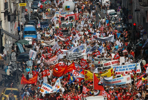 Workers of the private sector and public services demonstrate through the streets of Marseille, southern France, Tuesday, Sept. 10, 2013, as they protest against the government pension reforms. (AP Photo/Claude Paris)