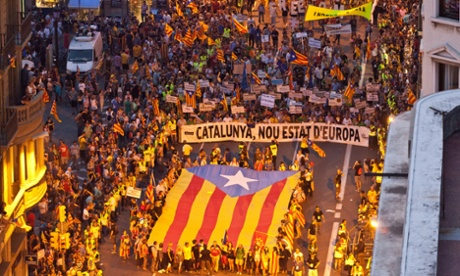 A huge Catalan separatist flag heads the demonstration during a protest in Barcelona demanding independence from Spain