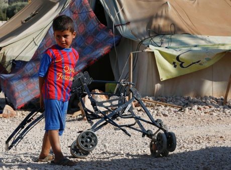 A Syrian refugee child who arrived with his fam