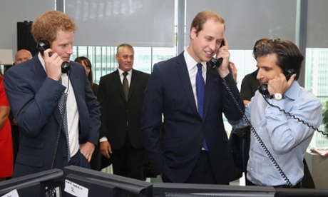 Britain's Prince Harry (L) and Prince William (2nd R) take part in a trade on the trading floor of BGC Partners in London September 11, 2013. The company, formerly part of Cantor Fitzgerald, holds a Charity Day each year to commemorate the 658 employees who lost their lives in the 9/11 attacks on the World Trade Centre in New York.