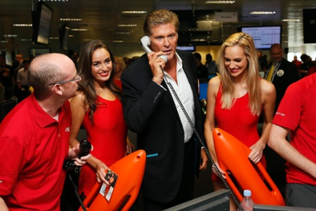 American actor David Hasselhoff (C) takes part in a trade on the trading floor of BGC Partners in London September 11, 2013.