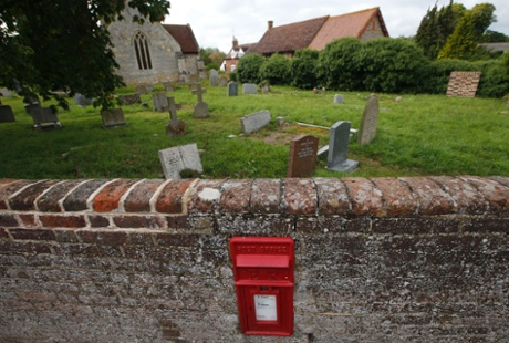 A Royal Mail post box is set into the wall around the churchyard in the village of Sydenham, September 12, 2013