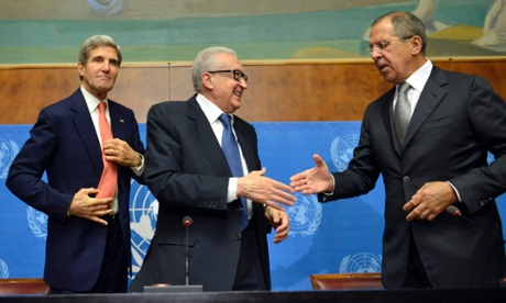 Lakhdar Brahimi, center, UN Joint Special Representative for Syria, shakes hands with Sergei Lavrov, Russian Foreign Minister, next to John Kerry, US Secretary of State, after their meeting at the United Nations in Geneva, Switzerland