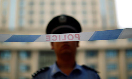 Police officers china detain multi-millionaire investor