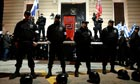 Members of the Golden Dawn party guard a stage during a rally in Athens earlier this year