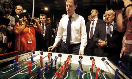 Nick Clegg plays table football at Lib Dem conference