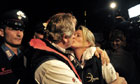 Senior salvage master Nick Sloane kisses his wife after the operation to right the Costa Concordia
