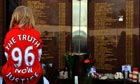 A Liverpool fan in front of the Hillsborough memorial at Anfield