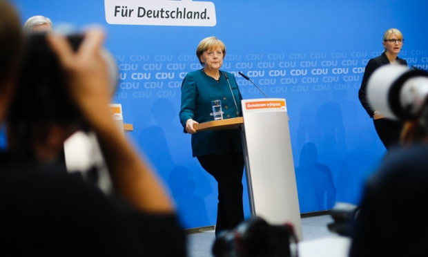 German Chancellor and chairwoman of the German Christian Democratic party, CDU, Angela Merkel listens to a question during a news conference after a meeting of the party's board  in Berlin Monday, Sept. 23, 201