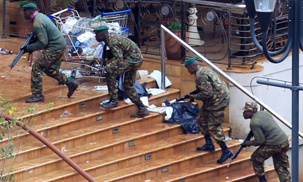 Kenya Defence Forces soldiers take their position at the Westgate shopping centre, on the fourth day since militants stormed into the mall, in Nairobi September 24, 2013.