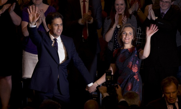 Ed Miliband and his wife Justine Thornton wave at the end of his speech to the Labour conference on 24 September 2013.