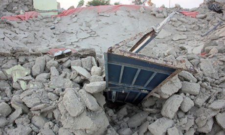 The rubble of a house in Awaran district after the magnitude 7.7 earthquake in Pakistan