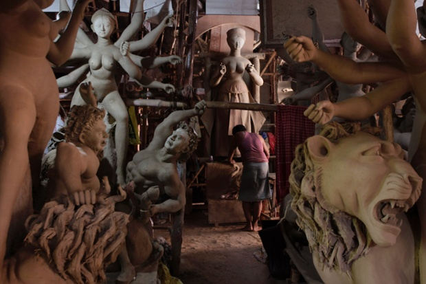 An artist prepares an idol at a workshop ahead of Durga Puja festival in New Delhi, India. The five-day Durga Puja festival that commemorates the slaying of a demon king by goddess Durga to mark the triumph of good over evil begins Oct. 10.