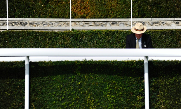 A racegoer wears a Panama hat on a warm day at Goodwood racecourse in Chichester, England.
