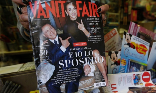 A copy of the Italian edition of Vanity Fair magazine, carrying a photo of Silvio Berlusconi, left, and his girlfriend Francesca Pascale, as it is displayed at a newsstand in Rome, Wednesday, Sept. 25, 2013.