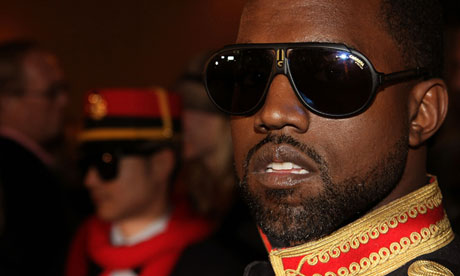Rapper Kanye West poses at the Devi Kroell fashion show