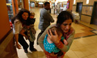 Women carrying children in Westgate shopping centre