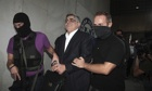 Golden Dawn leader Nikos Michaloliakos is escorted by anti-terror police